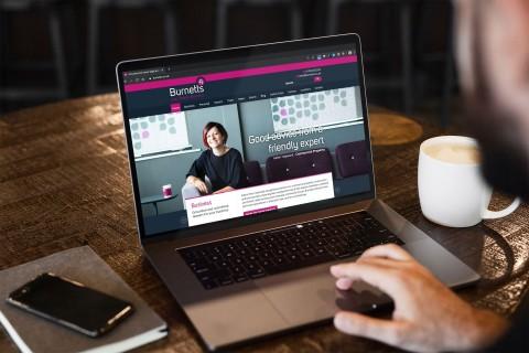 Burnetts website on laptop